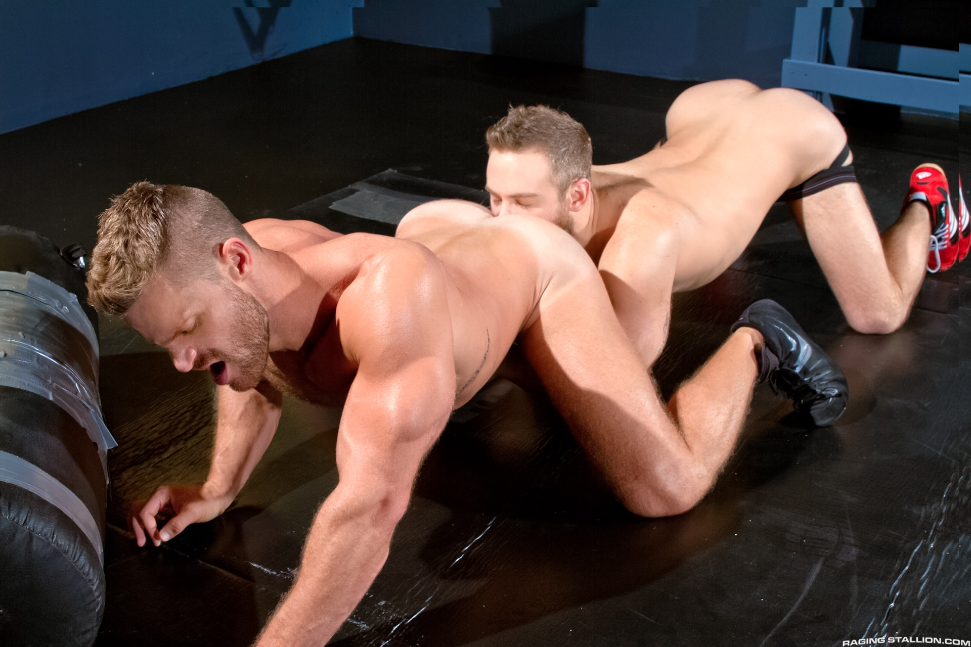 Shawn Wolfe and Landon Conrad flip-fuck in the gay porn film Cock Fight by Raging Stallion.
