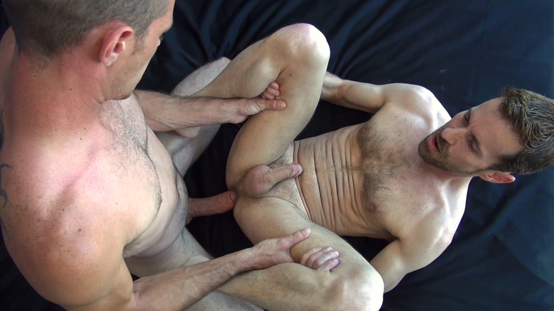 Brett Bradley fucks Sean Storm bareback on gay porn site Raw Fuck Club.